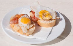 Quail egg and bacon sandwiches Royalty Free Stock Image