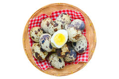 Quail egg in basket isolated on white Royalty Free Stock Photos
