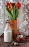 Quail egg with bottle of milk and flowers Royalty Free Stock Images