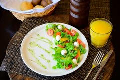 Quail Egg Salad with Lettuce and Tomatoes on a Plate stock image