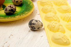 Quail egg on white wooden background. Easter card Royalty Free Stock Images