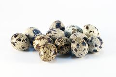Quail eggs. Group of quail eggs on a white background Royalty Free Stock Photo