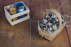 Quail eggs in bamboo basket On the old wood table. Background stock photo