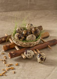 Quail eggs on bamboo pad. Quail eggs and wheat  on bamboo pad Stock Photo
