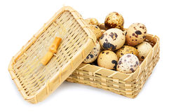 Quail eggs in basket. On white Royalty Free Stock Photography