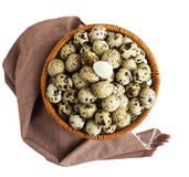 Quail eggs in a basket . A lot of. Isolated Royalty Free Stock Photo