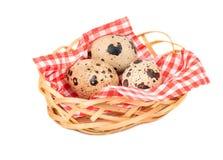 Quail eggs in basket. Raw quail eggs in solomani basket on white background Royalty Free Stock Photo