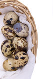 Quail eggs in a basket on a white Stock Images