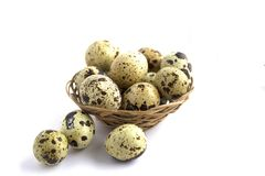 Quail eggs in a basket on a white background. Healthy lifestyle. Diet food. stock image