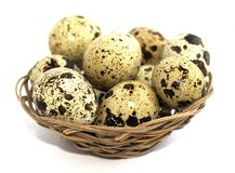 Quail eggs in a basket on a white background. Protein diet. Healthy diet. Blurred focus royalty free stock images