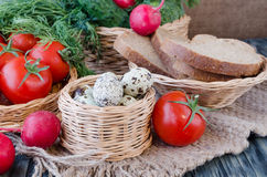 Quail eggs in a basket wicker. Quail eggs in a basket on wicker background fresh vegetables Royalty Free Stock Photo
