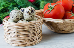 Quail eggs in a basket wicker. Quail eggs in a basket on wicker background fresh vegetables Stock Photos