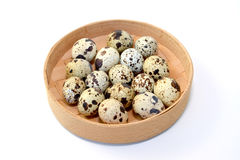 Quail eggs in a birch bark bast basket on a white background Stock Images