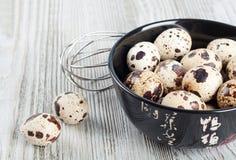 Quail eggs in a black dish Royalty Free Stock Photo