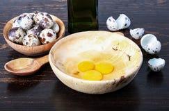 Quail eggs, bowl, broken eggs Stock Images