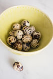 Quail eggs in a bowl on a table Royalty Free Stock Photos