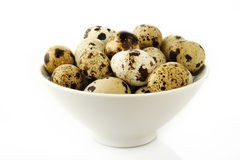 Quail eggs in bowl Stock Photo
