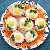 Quail eggs with bread on a plate. Blue background Royalty Free Stock Photos