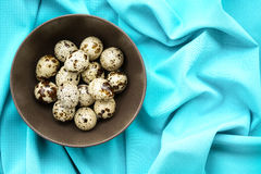 Quail eggs. In a brown plate stock photo