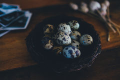 Quail Eggs on Brown Wicker Container Stock Photography