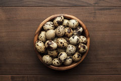 Quail eggs on the brown wooden table Royalty Free Stock Photos