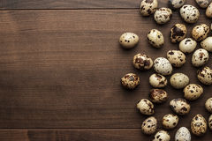 Quail eggs on the brown wooden table Royalty Free Stock Photography