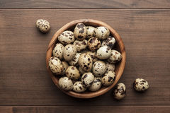 Quail eggs on the brown wooden table Royalty Free Stock Image