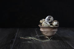 Quail eggs in clay pot on dark background. Healthy food concept Royalty Free Stock Photo