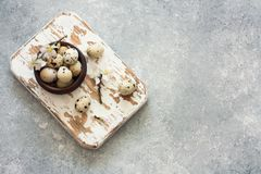 Quail eggs in a clay pots Stock Image