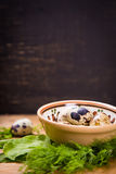 Quail eggs in dish. Some small quail eggs in dish  with fresh dill and sorrel Royalty Free Stock Image