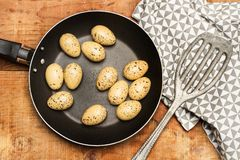 Quail eggs in a frying pan royalty free stock photo
