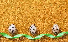 Quail eggs on golden sparkling background. Easter concept Royalty Free Stock Photo