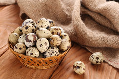 Quail Eggs In A Wicker Basket On The Background Of Wooden Planks Royalty Free Stock Photography