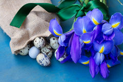 Quail eggs and irise flowers Royalty Free Stock Images