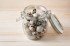 Quail eggs in a jar Stock Image