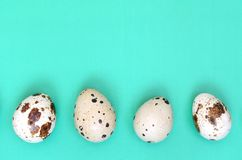 Quail eggs on a light green surface, top view, empty place for t. Ext, recipe stock photography