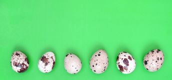 Quail eggs on a light green surface, top view, empty place for t. Ext, recipe royalty free stock image