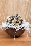 Quail eggs lying in a wooden bowl Royalty Free Stock Photo
