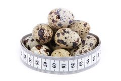 Quail eggs and measuring tape Royalty Free Stock Photography
