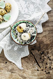 Quail eggs with a mixture of black and white salt Royalty Free Stock Photography
