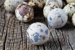 Quail eggs on old brown wooden surface Royalty Free Stock Photo