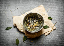 Quail eggs in an old pot and a Bay leaf. On the stone table royalty free stock photos