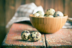 Quail eggs on old wooden table Royalty Free Stock Photos