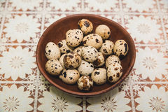 Quail eggs are on the openwork tablecloth Stock Photos