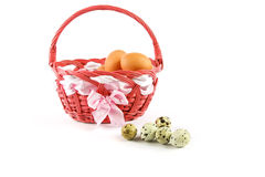 Quail eggs and pink basket Stock Photography