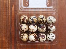 Quail eggs in a plastic box royalty free stock photos