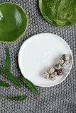 Quail eggs on a plate. Decorative plate with a pattern Royalty Free Stock Photography