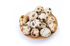 Quail eggs on a plate isolated on white background Royalty Free Stock Image