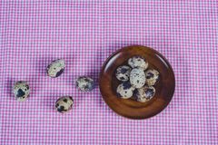 Quail eggs in plate On the old wood table. Background stock photography