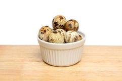 Quail eggs in ramekin Stock Photos